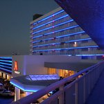 hotel at night with exterior doors to rooms