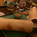 Butter chicken dosa. The side sauces are amazing!