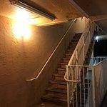 dim lights, broken tiles, rusty railing -- too bad you can't hear the train...