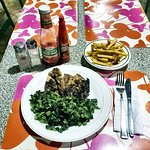 Classic Jerk Chicken and Callaloo Greens with a side of Fries.  JMAC
