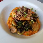 Blackened fish of the day with creamed sweet potato and vegetables.