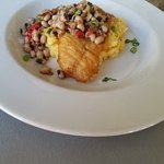 Fish and grits with black eye pea salad