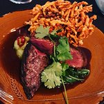 Char-grilled kangaroo sirloin with quandong (native fruit) glaze, sweet potato and bokchoi