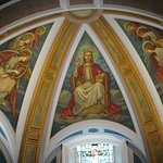 Detail of painted ceiling in apse of St Cuthbert's Church