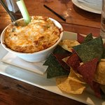 Artichoke-spinach-cream cheese dip with nachos