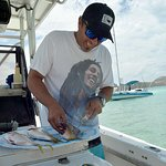 Captain Dave prepares the yellowtail