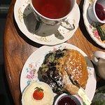 tea and blueberry scone with cream and raspberry jam