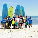 Group of happy and tired surfers.