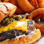 The People's Burger features bacon mayo, pablano peppers, and our house made cheddar chive chees