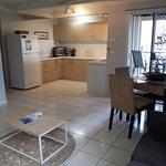 Airlie Apts poolside apt - lounge, kitchen, dining