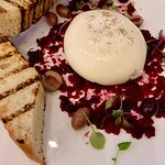 burrata with toast, beets and olives
