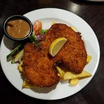 Chicken Schnitzel with thick cut chips and onion gravy.