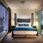 Trinity Wharf Suite bedroom with incredible floor to ceiling water views