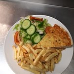 Yummy quiche with salad and chips
