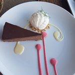 Chocolate cheesecake with vanilla ice cream
