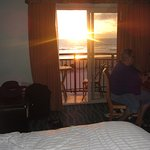 watching the sun set from our room, left sliding door open everynight to listen to surf fromocea
