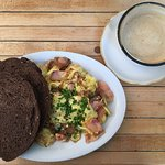 Eggs, Salmon and pumpernickel toast with cappuccino