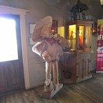 Wooden statue by door.