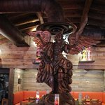 Wooden statue in dining area.