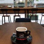 Shafted cafe at ground level. Serves good espresso