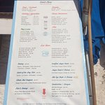 Just passing this very busy restaurant with a queue outside at 16:00. Tables on the beach and bo