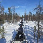 A trail to the lake for snowmobiling practice.