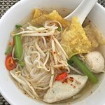 Breakfast live counter serving of Thai noodle soup with pork dumplings