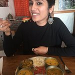 enjoying the first bite of veg thali