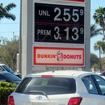 the corner sign for Dunkin' Donuts