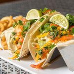 Grilled Fish Tacos - fresh and local, served with curly-q fries and our tropical mango salsa!