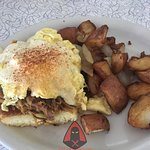 Southern Eggs Benedict (sweet cornbread, spicy cooked pork, eggs and hollandaise)