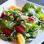 Power Salads - baby greens topped with citrus segments, edamame, feta, seasonal berries and more