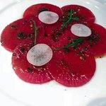Watermelon radish carpaccio, champagne vinaigrette