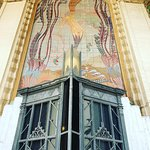mermaid over front door with gold leaf & tiles