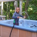 Maintenance crew (grandson) filling the Hot Tub