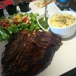 Yesterday's T-Bone served with mashed potatoes w/cheese and salad.