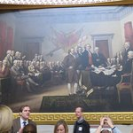 Thomas Jefferson is stepping on John Adams' toes in this painting