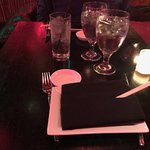 Absolutely tiny table even for two people, and uncomfortably high.