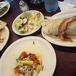 taco al pastor in front (pork), taco loco to the right, chicken tacos to the left.