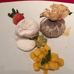 Baked mango parcel with vanilla infused glutinous rice and coconut ice cream