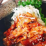 Teriyaki Chicken on rice  Grilled chicken with teriyaki sauce served with rice and salad.