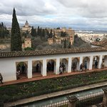 An amazing view of the lower Alhambra from the gardens, fountains and portico above