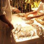 Chefs preparing fresh fish for the BQ evening