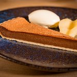 Milk chocolate tart with poached pear
