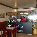 The Owner & staff inside the restaurant.