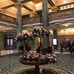 This beautiful building's grandeur is enhanced by the lovely floral displays.