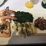 Mixed grilled seafood special: jumbo shrimps, salmon, red snapper and octopus