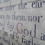 Hand-painted psalms are dotted around the church