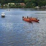 Mauri war canoe headed up to falls