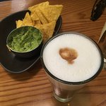 Latte and chips with guacamole